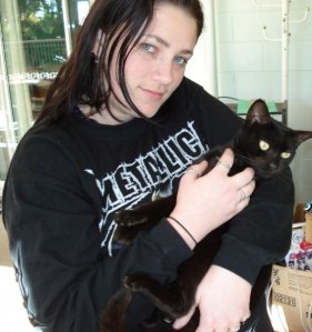 A teenaged me with Zelda, my sister's cat. The same sister that pooped out a BABY HUMAN named Zelda
