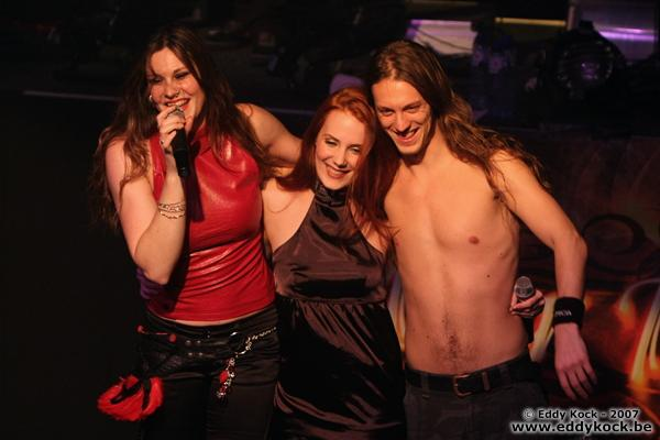 Seriously, look at her tower over Simone Simons and Mark Jansen